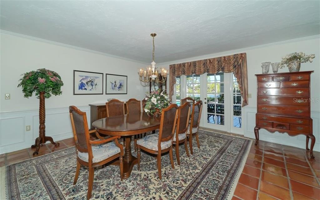 Large formal dining room opens to the lanai - Single Family Home for sale at 510 63rd St Nw, Bradenton, FL 34209 - MLS Number is A4424601