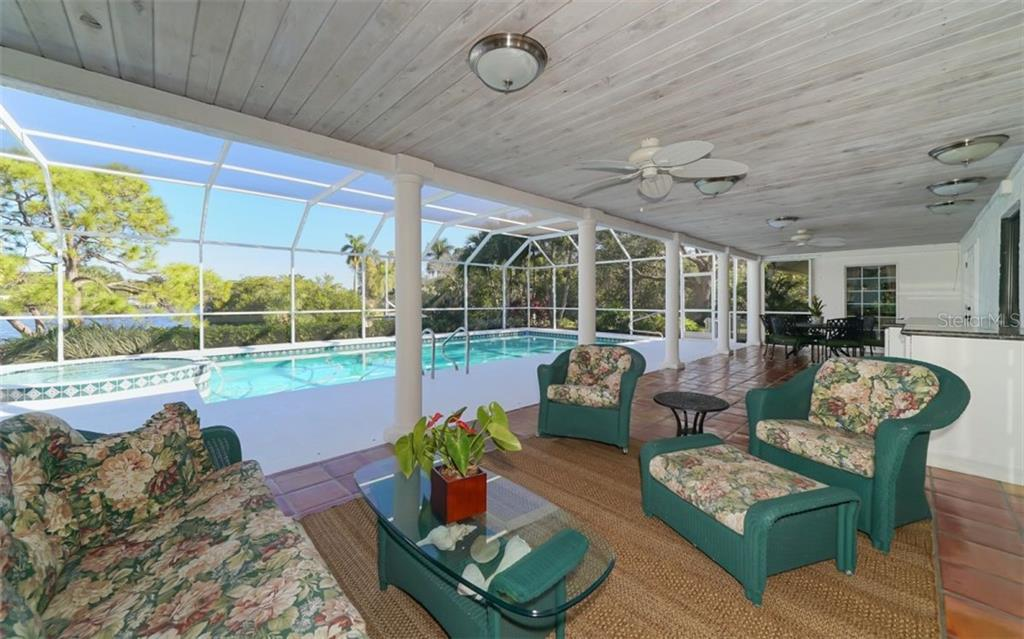 Hot tub and pool with the bayou beyond - Single Family Home for sale at 510 63rd St Nw, Bradenton, FL 34209 - MLS Number is A4424601