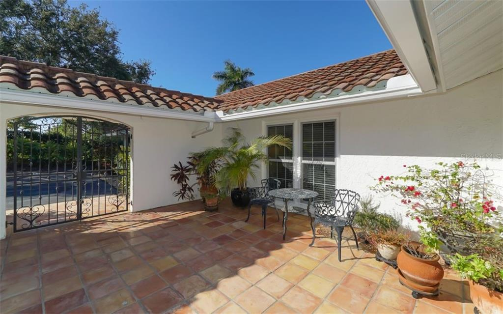 Courtyard entry - Single Family Home for sale at 510 63rd St Nw, Bradenton, FL 34209 - MLS Number is A4424601