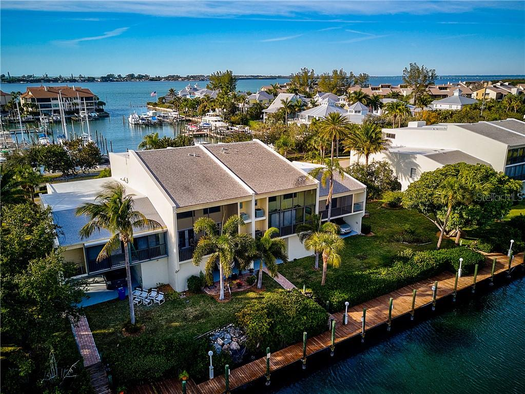 Aerial View of the back of the Condo & Canal Access - Condo for sale at 4115 129th St W #4115, Cortez, FL 34215 - MLS Number is A4424939