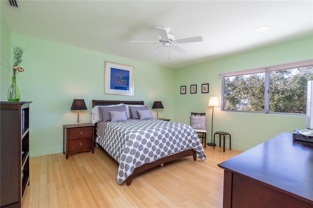 One of two Guest suites with walk-in closets, recessed lighting, bamboo flooring, and hurricane-grade windows overlooking the waterway! - Single Family Home for sale at 509 Venice Ln, Sarasota, FL 34242 - MLS Number is A4425092