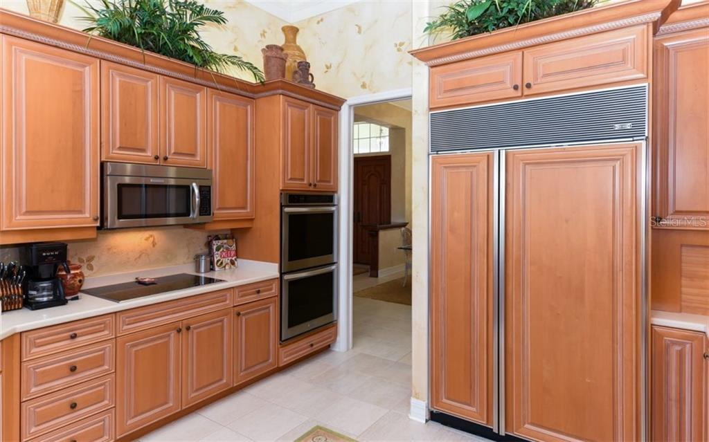 Notice the Hand Painted and Textured walls throughout the house. - Single Family Home for sale at 561 Ketch Ln, Longboat Key, FL 34228 - MLS Number is A4426280
