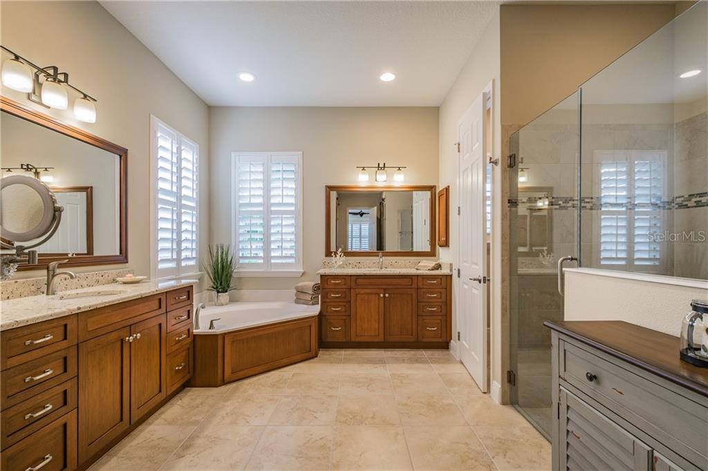 Master Bath including his and hers sinks, bathtub and walk in shower.  Separate toilet closet includes a bidet. - Single Family Home for sale at 595 Fore Dr, Bradenton, FL 34208 - MLS Number is A4428657