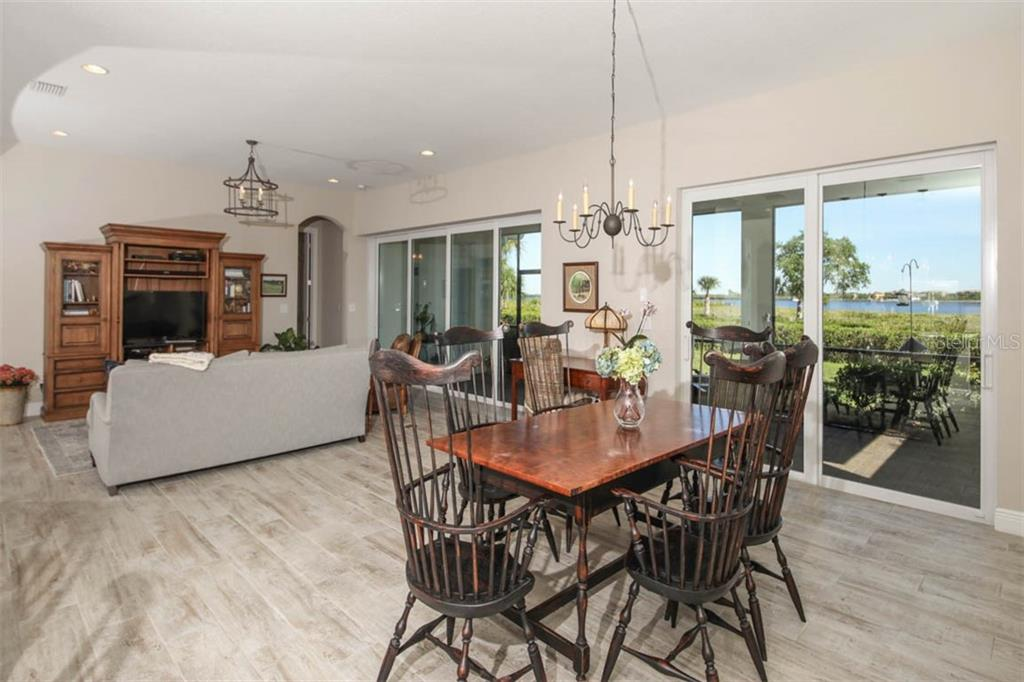 Plenty of Dining space in the great room and another set of sliders - Single Family Home for sale at 5504 Tidewater Preserve Blvd, Bradenton, FL 34208 - MLS Number is A4429479