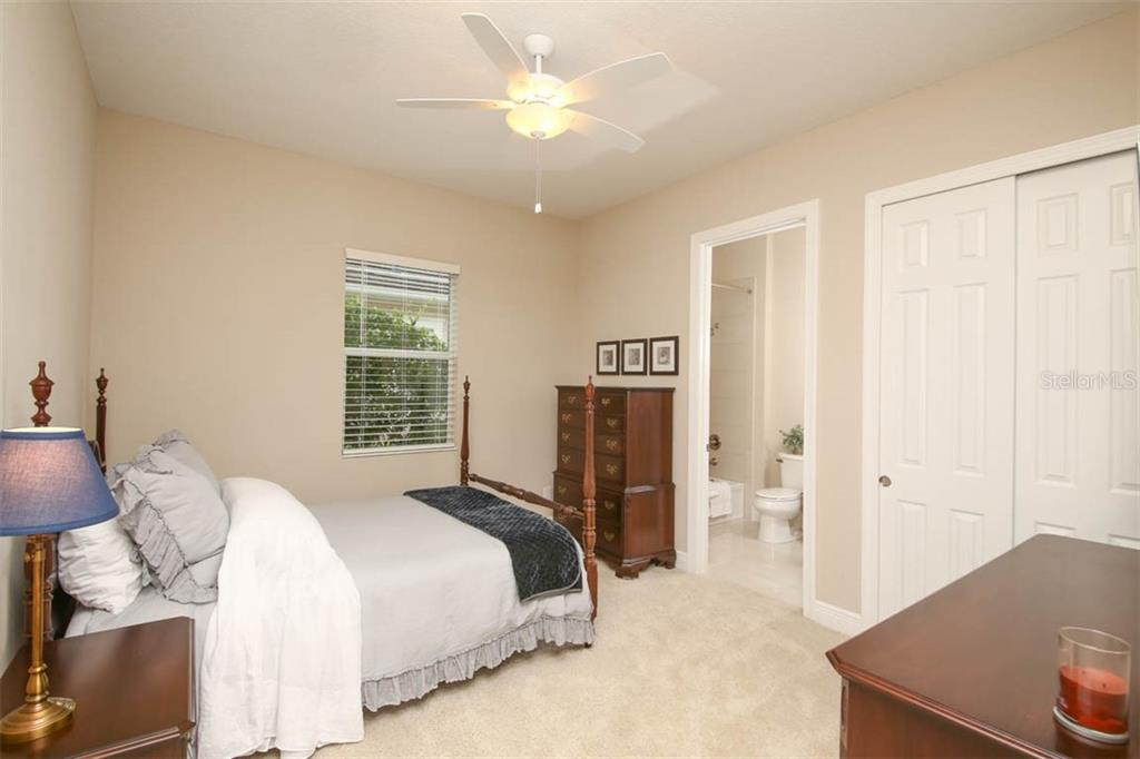 Bedroom 3 downstairs with full en-suite bathroom - Single Family Home for sale at 5504 Tidewater Preserve Blvd, Bradenton, FL 34208 - MLS Number is A4429479