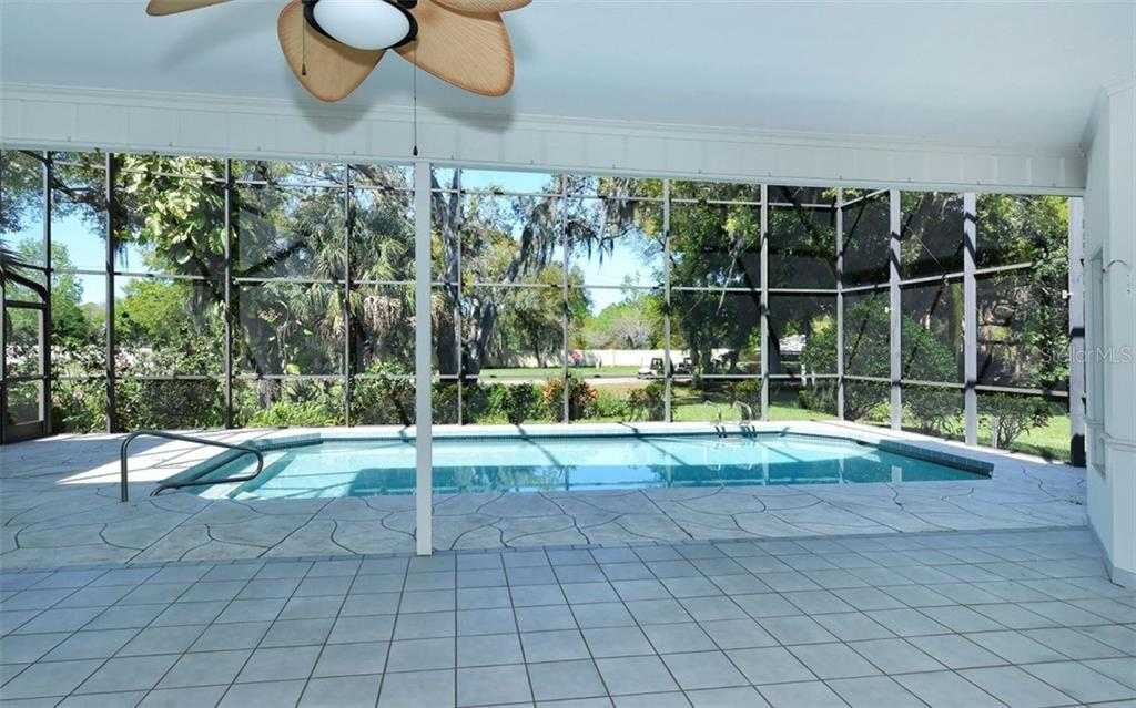 Plenty of undercover space to create a tropical oasis for entertaining - Single Family Home for sale at 1636 Liscourt Dr, Venice, FL 34292 - MLS Number is A4429524