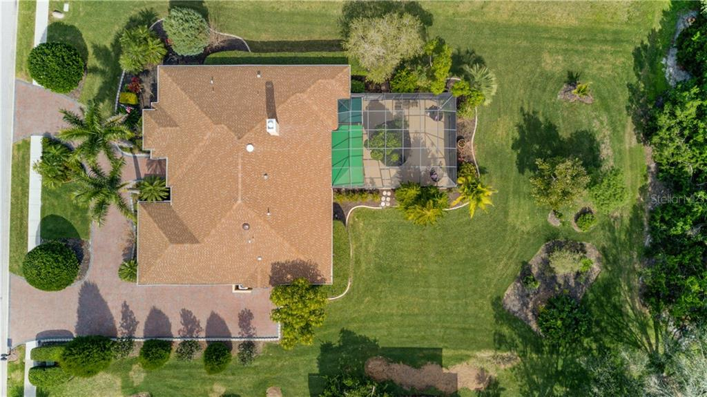 Beautiful 1/2 acre lot, and room to park 7 vehicles without moving one to get out! - Single Family Home for sale at 6321 W Glen Abbey Ln E, Bradenton, FL 34202 - MLS Number is A4429610
