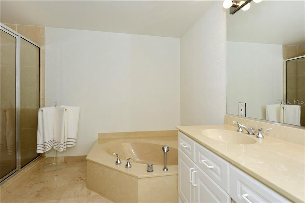 Glorious Stone Design Master Bath - Condo for sale at 1800 Benjamin Franklin Dr #b309, Sarasota, FL 34236 - MLS Number is A4430464