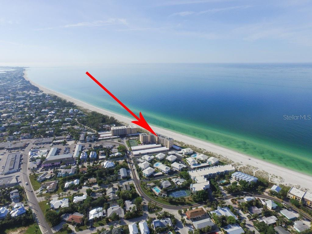 Relax and enjoy Gulf front views in the bright and spacious living room! - Condo for sale at 5300 Gulf Dr #406, Holmes Beach, FL 34217 - MLS Number is A4430634