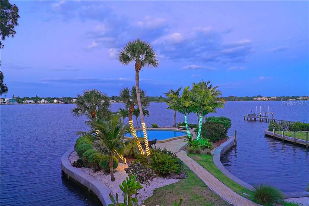 Heated salt water pool on the bayfront on a private peninsula. - Single Family Home for sale at 6841 Peacock Rd, Sarasota, FL 34242 - MLS Number is A4430828