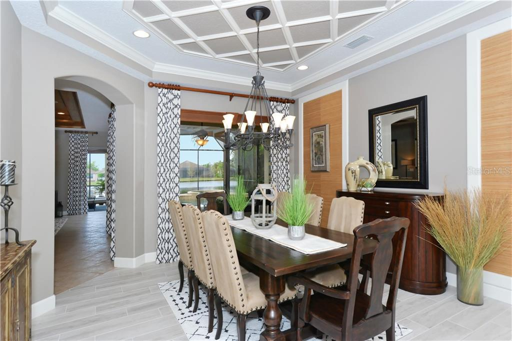Dining Room with a lovely lake view - Single Family Home for sale at 14231 Sundial Pl, Lakewood Ranch, FL 34202 - MLS Number is A4430945