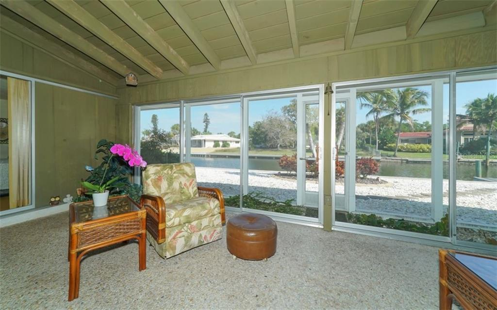 FLORIDA ROOM OVERLOOKING CANAL - Single Family Home for sale at 935 Contento St, Sarasota, FL 34242 - MLS Number is A4431223