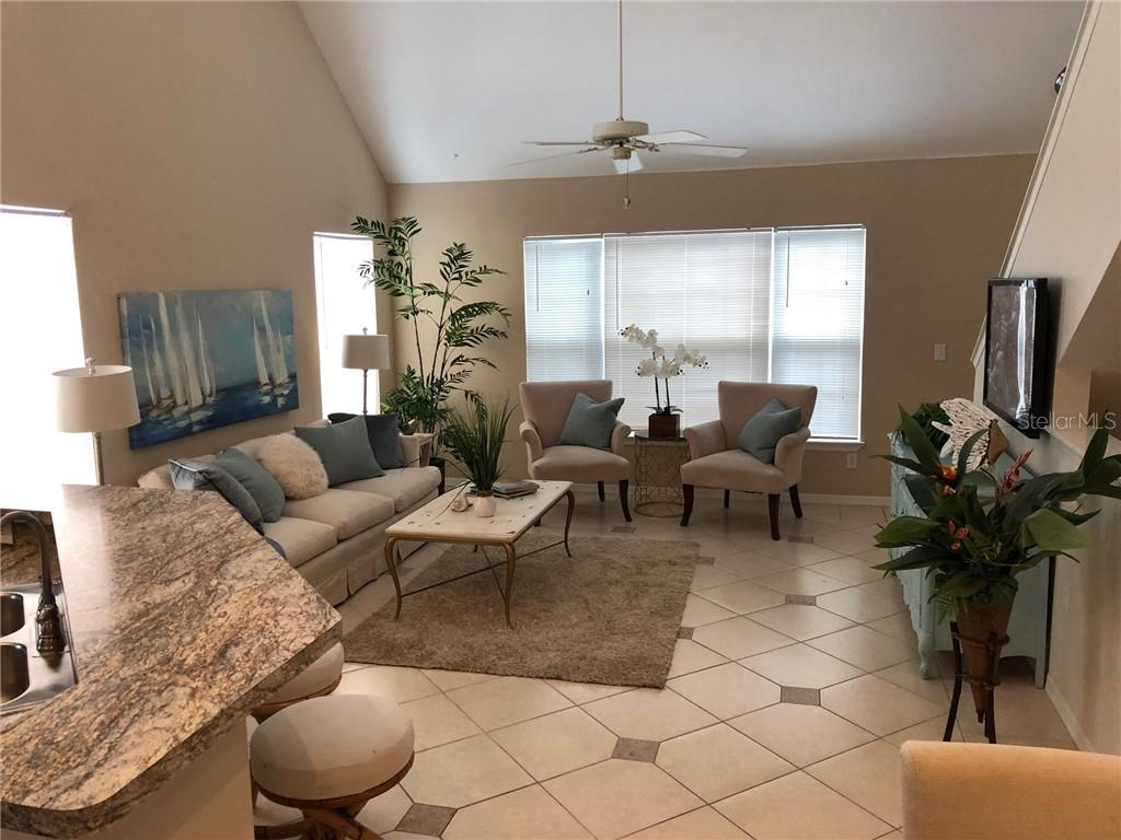 View of Main Living Area from Dining Area - Condo for sale at 5511 Rosehill Rd #201, Sarasota, FL 34233 - MLS Number is A4431621