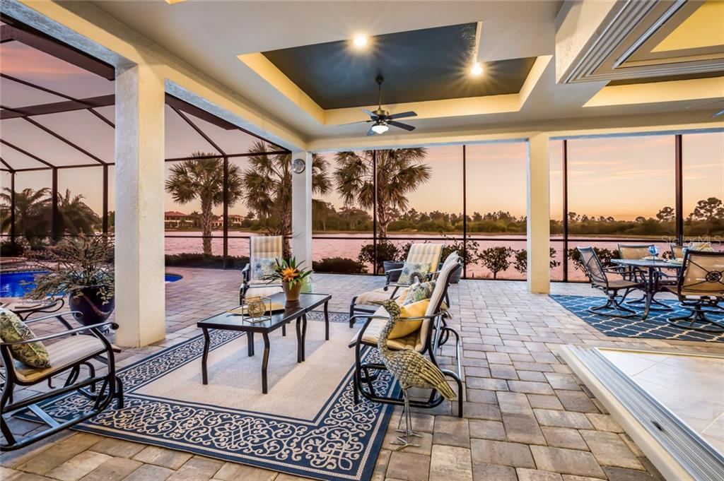 Pool deck has stunning views of the lake located behind the property. - Single Family Home for sale at 19432 Newlane Pl, Bradenton, FL 34202 - MLS Number is A4432094
