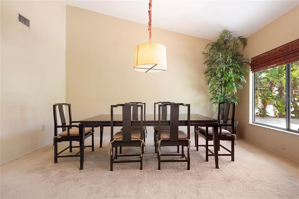 Dining Room. - Single Family Home for sale at 1302 Roberts Bay Ln, Sarasota, FL 34242 - MLS Number is A4433097