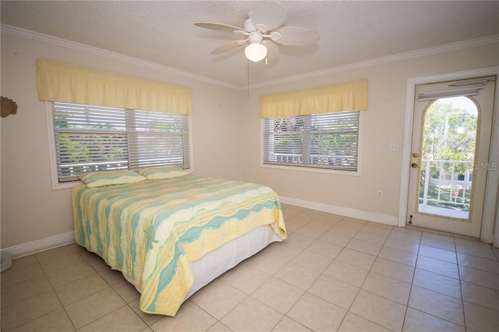 Bedroom 3(2nd Level) goes out to deck - Single Family Home for sale at 2405 Avenue A, Bradenton Beach, FL 34217 - MLS Number is A4433128
