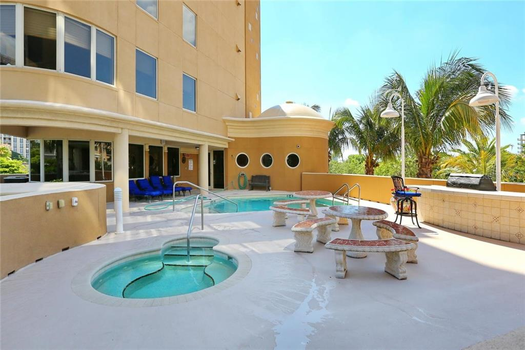 Open community area with heated pool and spa, great outdoor kitchen with gas grill and bar seating all overlooking Golden Gate Point and Water Vistas! - Condo for sale at 128 Golden Gate Pt #902a, Sarasota, FL 34236 - MLS Number is A4433296