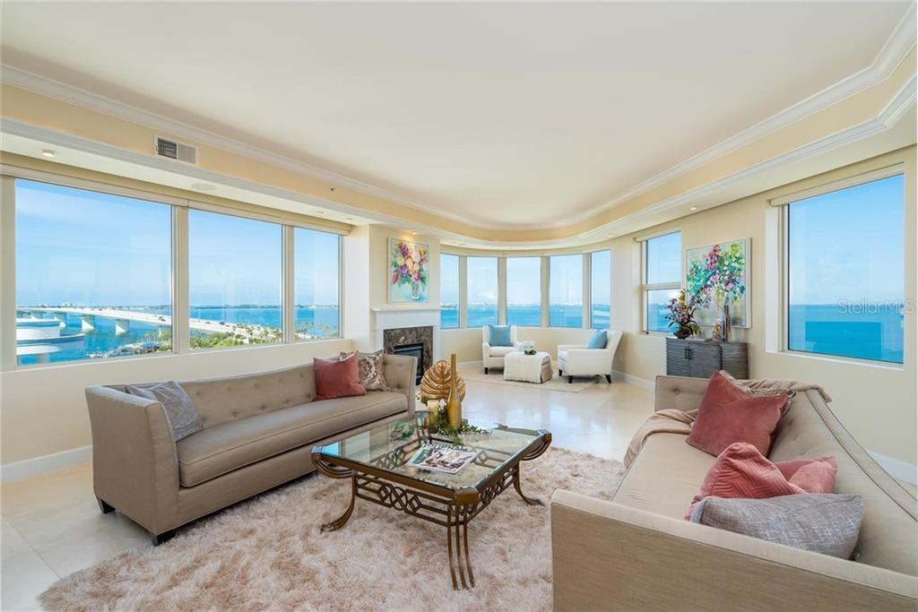 Spacious Great Room with panorama water vistas including the beautiful Ringling Bridge! - Condo for sale at 128 Golden Gate Pt #902a, Sarasota, FL 34236 - MLS Number is A4433296
