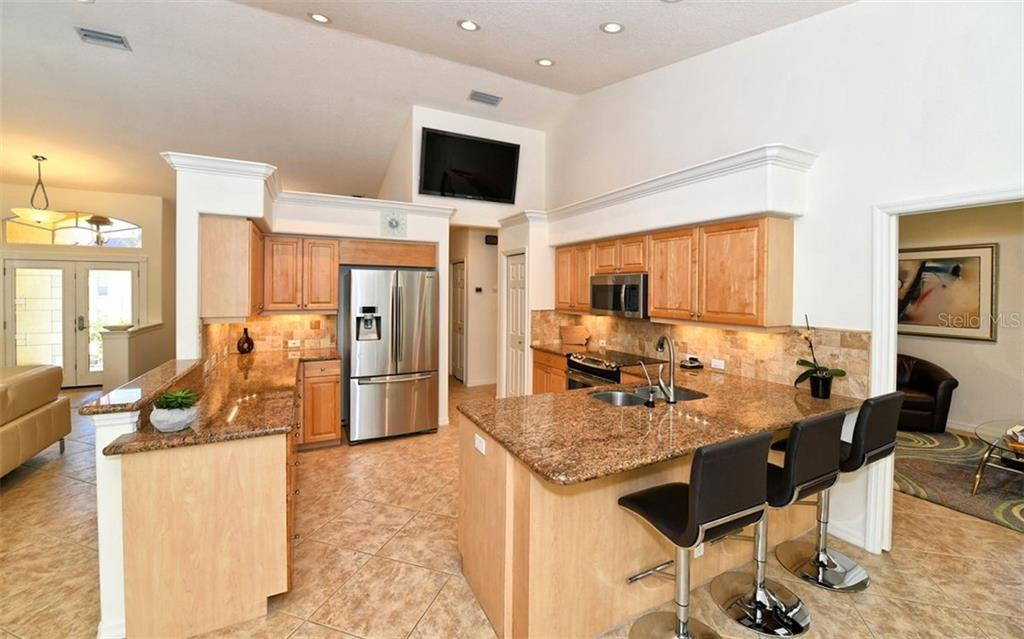 Granite countertops, breakfast bar, and stainless appliances - Single Family Home for sale at 3525 White Ln, Sarasota, FL 34242 - MLS Number is A4433441