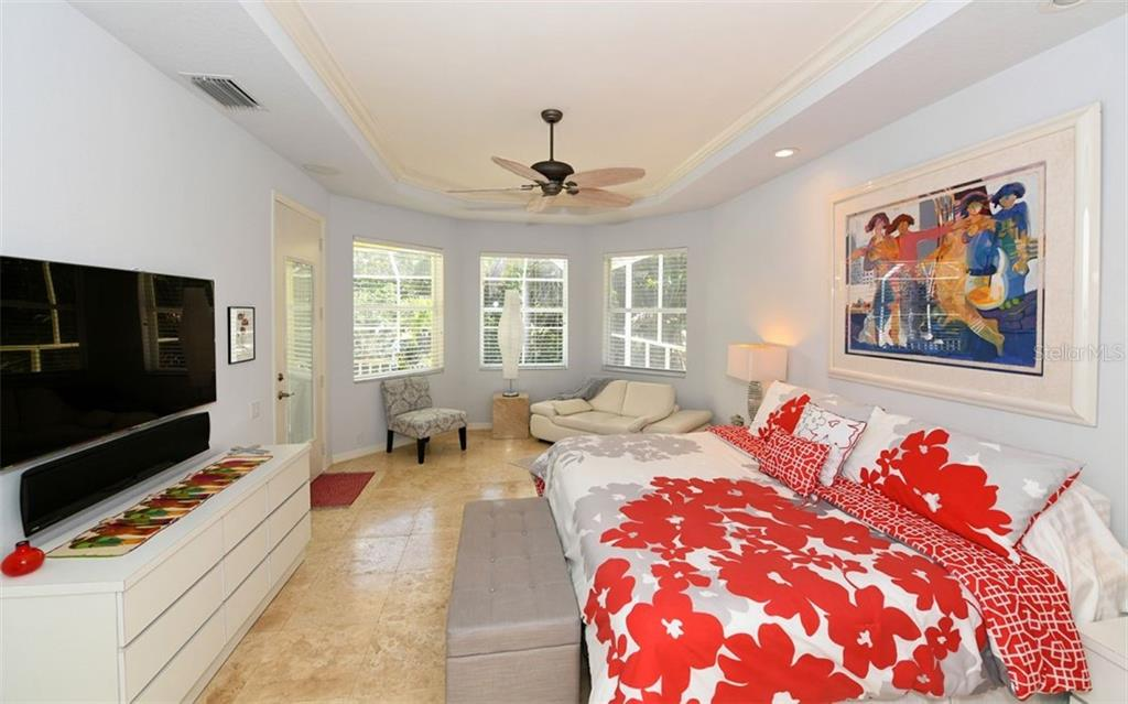 Spacious master suite with outdoor views opening to the balcony - Single Family Home for sale at 3525 White Ln, Sarasota, FL 34242 - MLS Number is A4433441