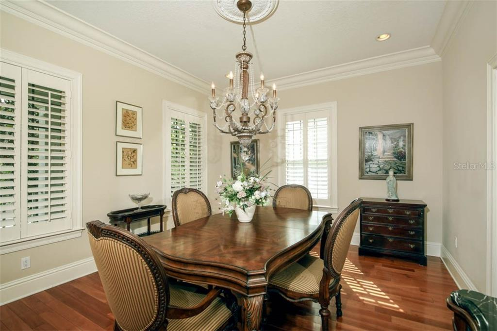 Formal dining room with plantation shutters, crown molding. - Single Family Home for sale at 7153 Hawks Harbor Cir, Bradenton, FL 34207 - MLS Number is A4434661