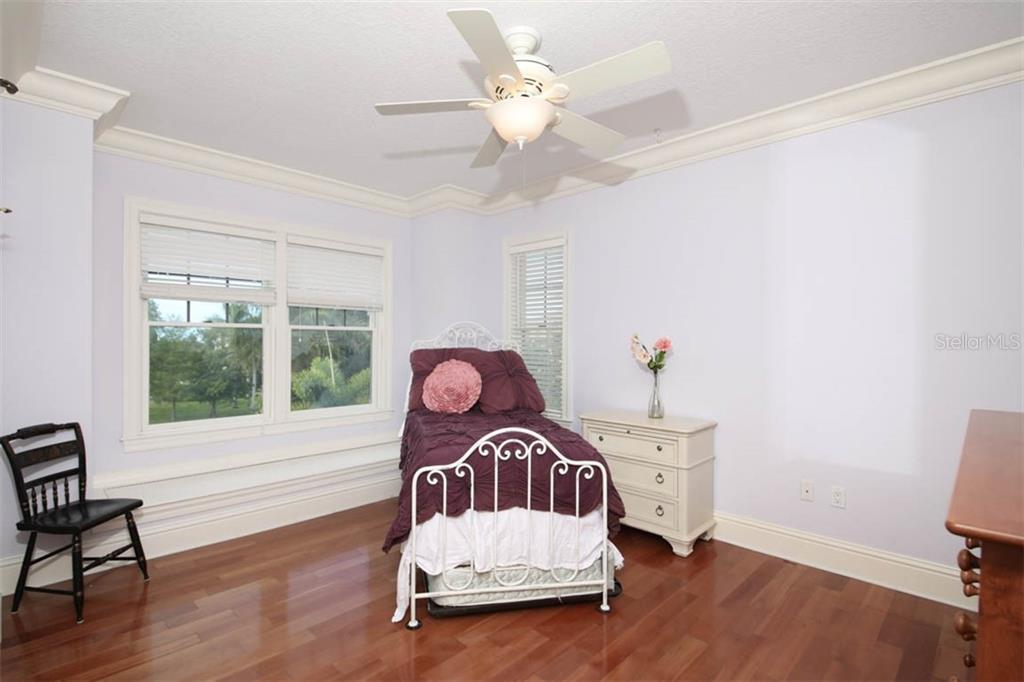 Bedroom 2 - Single Family Home for sale at 7153 Hawks Harbor Cir, Bradenton, FL 34207 - MLS Number is A4434661