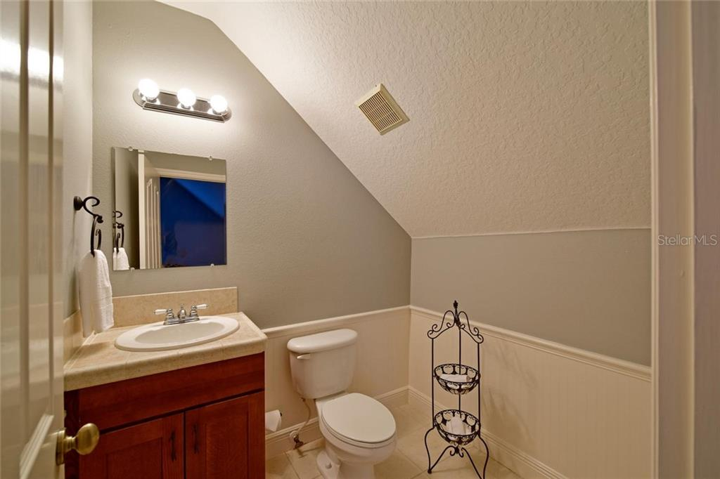 Half bath in bonus room above garage. Can easily be converted to a full bath. - Single Family Home for sale at 13825 18th Pl E, Bradenton, FL 34212 - MLS Number is A4435082