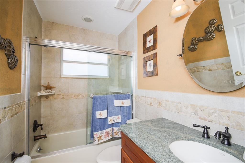 coastal-themed guest bath - Single Family Home for sale at 4448 Deer Trail Blvd, Sarasota, FL 34238 - MLS Number is A4435495
