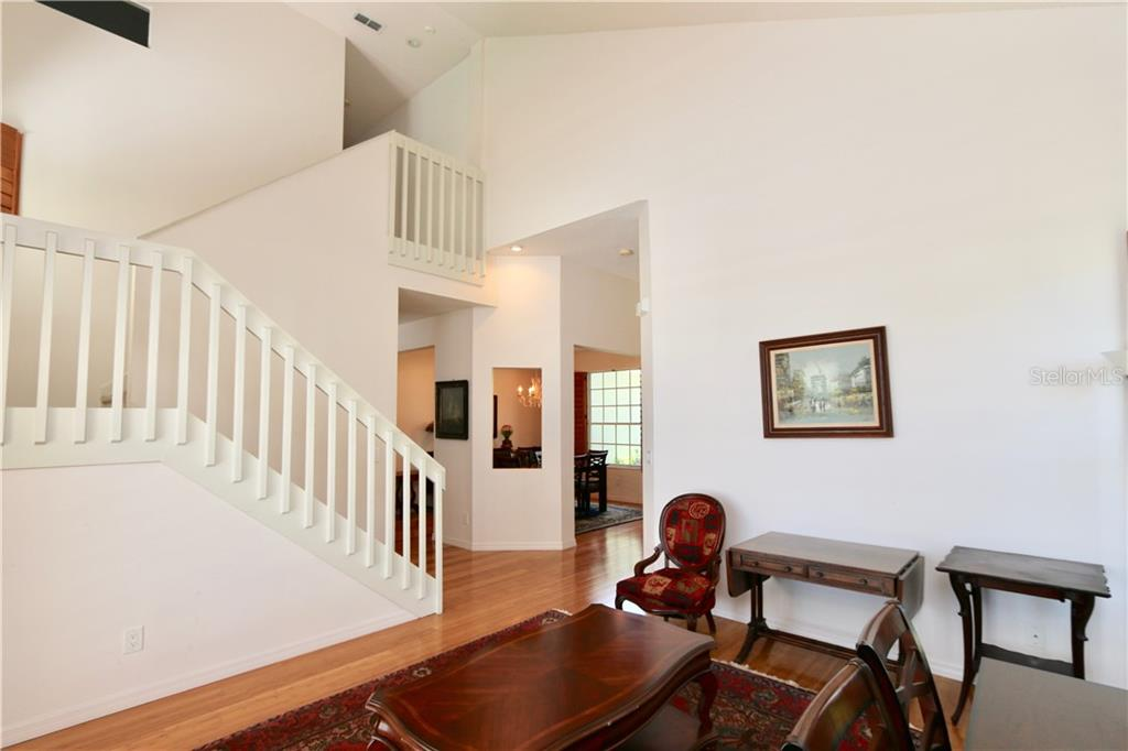 Stairs to second floor provides direct access from the foyer, dining room, living room and kitchen - Single Family Home for sale at 5082 47th St W, Bradenton, FL 34210 - MLS Number is A4435806