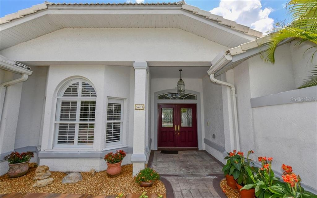 Covered front entry - Single Family Home for sale at 5401 Downham Meadows, Sarasota, FL 34235 - MLS Number is A4436577