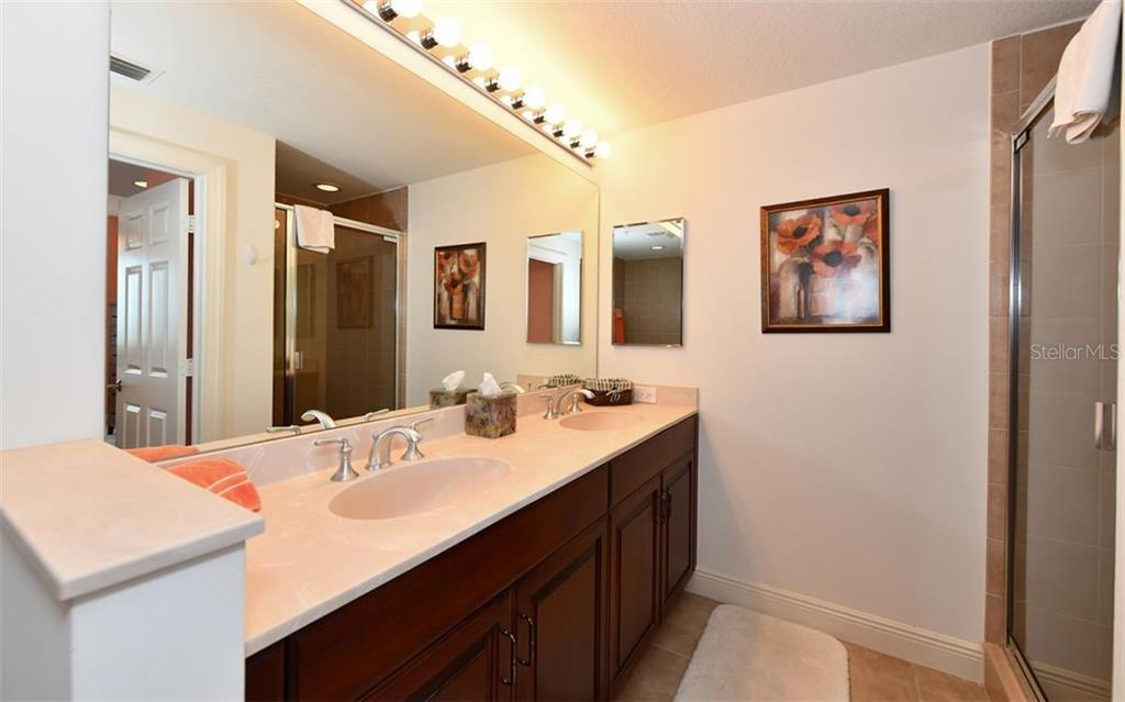 Master bath showing walk-in shower to the right - Condo for sale at 800 N Tamiami Trl #602, Sarasota, FL 34236 - MLS Number is A4436915