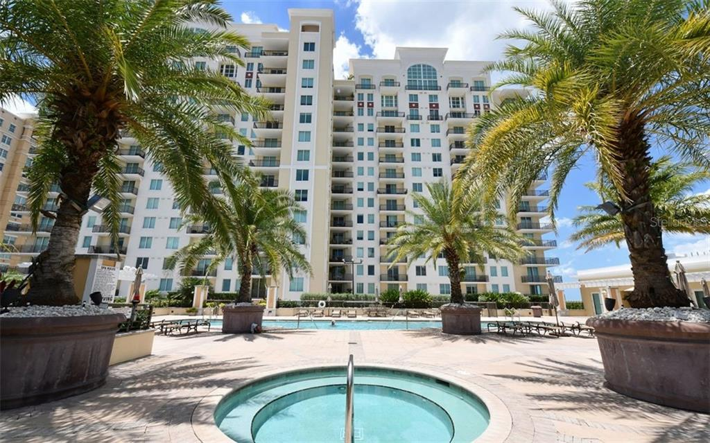 Spa with pool beyond - Condo for sale at 800 N Tamiami Trl #602, Sarasota, FL 34236 - MLS Number is A4436915