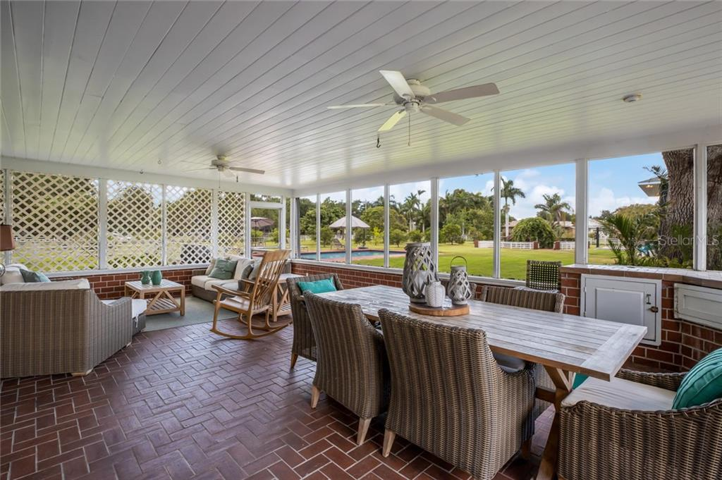 Huge screened patio off the kitchen, perfect for entertaining! - Single Family Home for sale at 590 Bayshore Dr, Terra Ceia, FL 34250 - MLS Number is A4437024