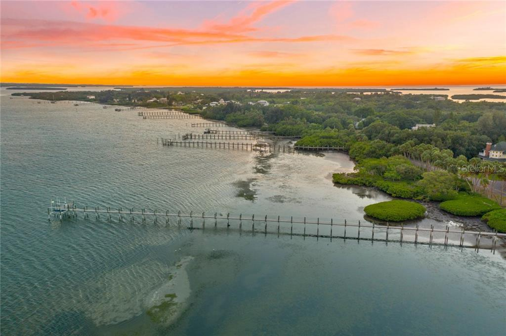 Amazing sunset over Terra Ceia Island with dock in the foreground. - Single Family Home for sale at 590 Bayshore Dr, Terra Ceia, FL 34250 - MLS Number is A4437024