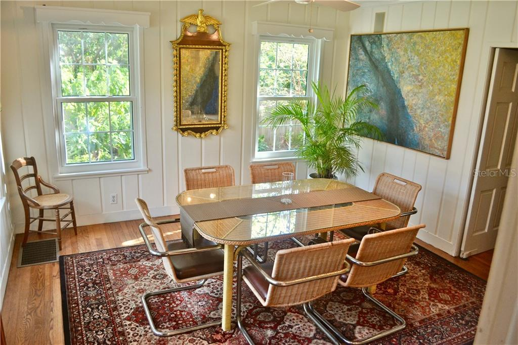 Welcome to your bright, sunny, spacious formal dining room. Notice the solid wood floors continue into this happy space! - Single Family Home for sale at 813 Hudson Ave, Sarasota, FL 34236 - MLS Number is A4437601