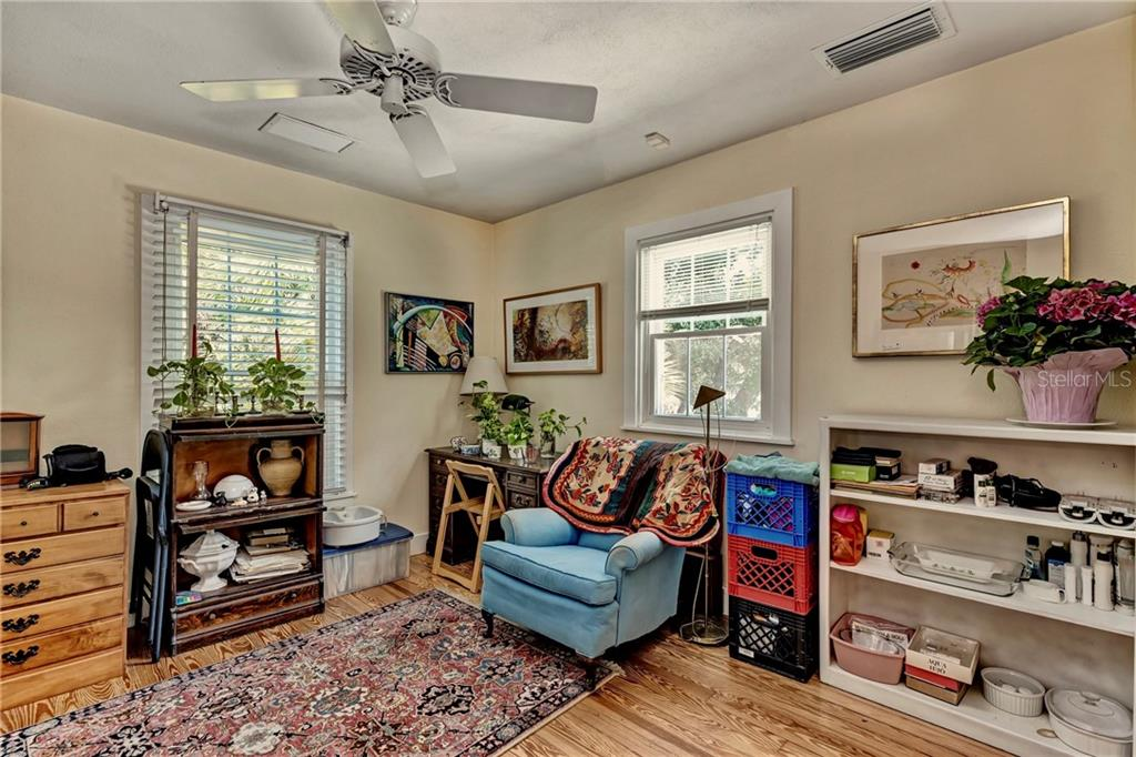 A second bedroom upstairs that also has an ensuite bathroom. It is currently being used as an office/sitting room. - Single Family Home for sale at 813 Hudson Ave, Sarasota, FL 34236 - MLS Number is A4437601