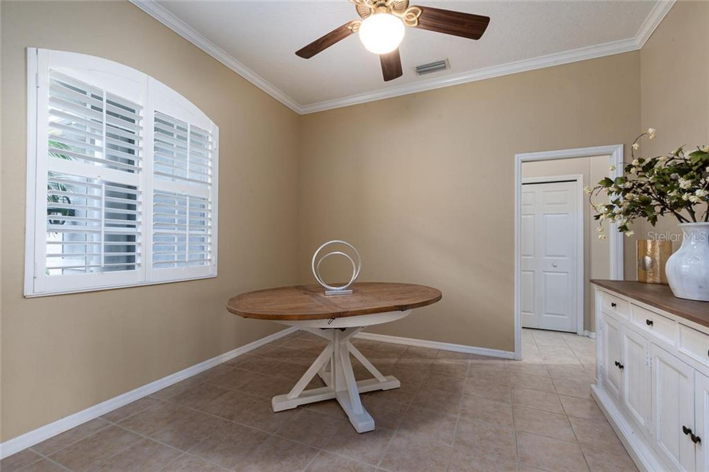 Study or formal dining room with glass french doors - Single Family Home for sale at 13818 Nighthawk Ter, Lakewood Ranch, FL 34202 - MLS Number is A4438487
