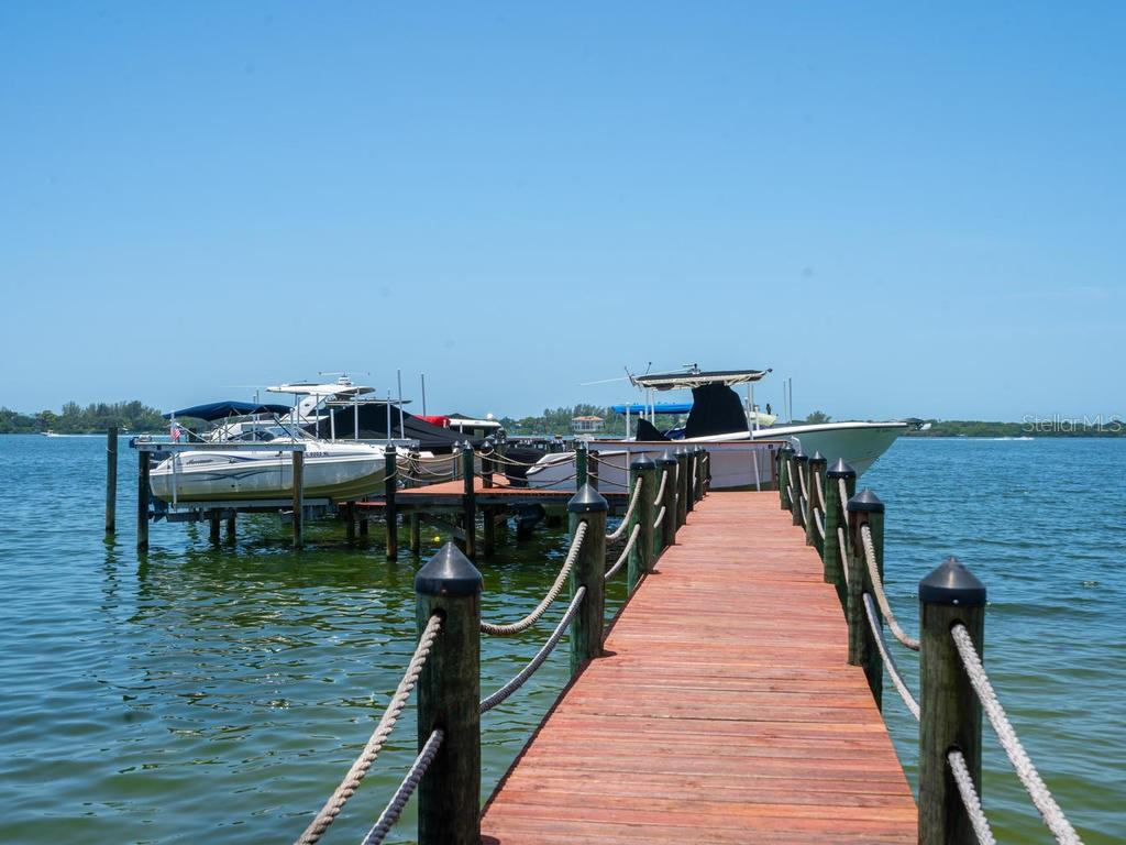 Community boat dock with deeded slips - Single Family Home for sale at 158 Puesta Del Sol, Osprey, FL 34229 - MLS Number is A4439362