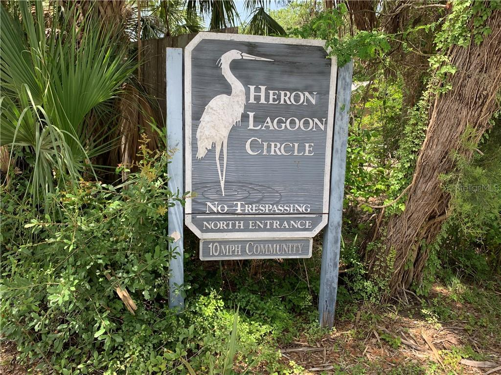 Heron Lagoon Circle entry sign - Single Family Home for sale at 8511 Heron Lagoon Cir, Sarasota, FL 34242 - MLS Number is A4439489