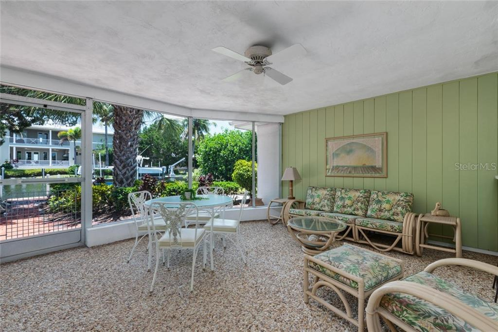 The kitchen is clean and tidy and has a view straight out to the water - Single Family Home for sale at 701 Norton St, Longboat Key, FL 34228 - MLS Number is A4440596