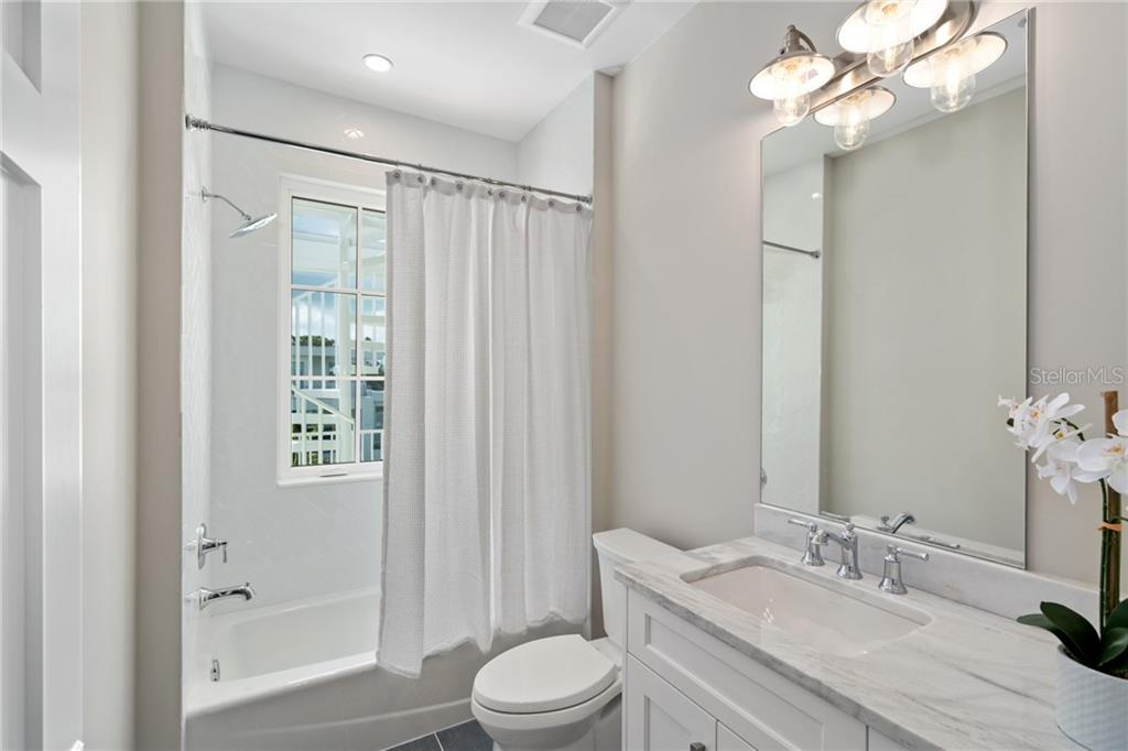 powder bath with changing room opening to the porch and pool - Single Family Home for sale at 1516 Sandpiper Ln, Sarasota, FL 34239 - MLS Number is A4442067