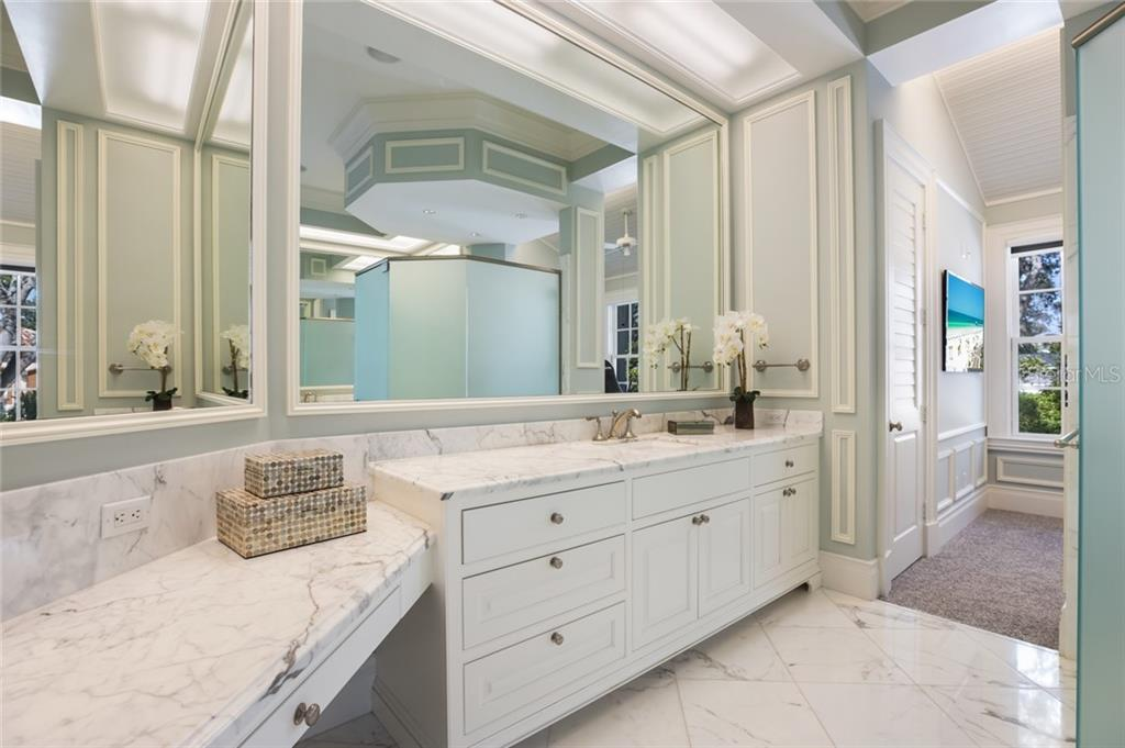 Master bathroom with fitness room - Single Family Home for sale at 1522 N Lake Shore Dr, Sarasota, FL 34231 - MLS Number is A4442286