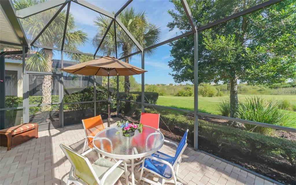 Extended pavered lanai. - Single Family Home for sale at 114 Padova Way #52, North Venice, FL 34275 - MLS Number is A4442496