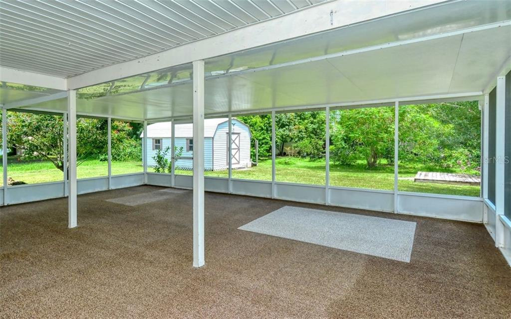 The lanai is covered and screened in which extends your living space and offers plenty of room for entertaining - Single Family Home for sale at 3286 Jamestown St, Port Charlotte, FL 33952 - MLS Number is A4444310