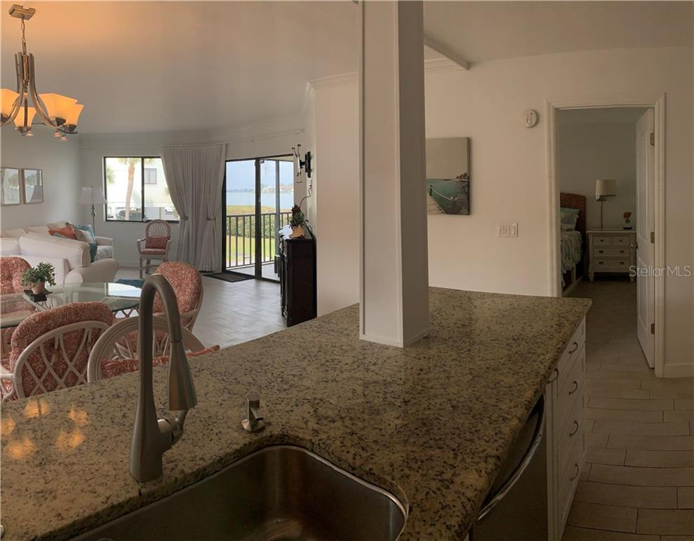 The relaxing lanai....imagine having your coffee here every morning! - Condo for sale at 501 Gulf Dr N #305, Bradenton Beach, FL 34217 - MLS Number is A4445601