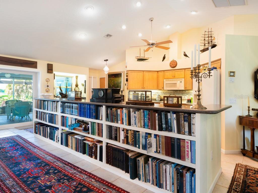 Bar-top seating converted to book shelves - Single Family Home for sale at 1716 Bayshore Dr, Englewood, FL 34223 - MLS Number is A4445961