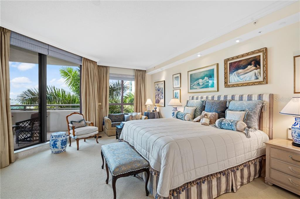 A relaxing palette of creams and muted blues wash away the day.  Floor to ceiling windows and doors flood the space with light and a large adjoining private sitting area affords the perfect place to unwind. - Condo for sale at 401 S Palm Ave #402, Sarasota, FL 34236 - MLS Number is A4446224