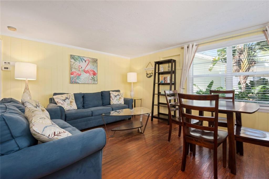 MERMAID Living Room. - Duplex/Triplex for sale at 516 Canal Rd, Sarasota, FL 34242 - MLS Number is A4446336
