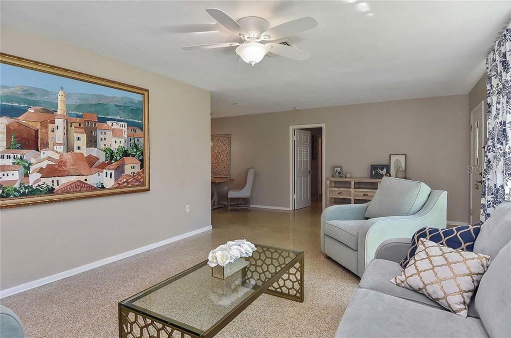 Living room to dining room - Single Family Home for sale at 105 Alba St E, Venice, FL 34285 - MLS Number is A4446473