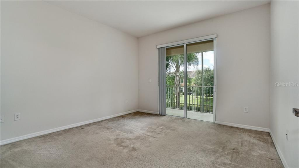 Owner's bedroom has relaxing view of pond with lily pads and wildlife. Turtles, ducks, geese and more. - Condo for sale at 7815 Moonstone Dr #24-204, Sarasota, FL 34233 - MLS Number is A4446867